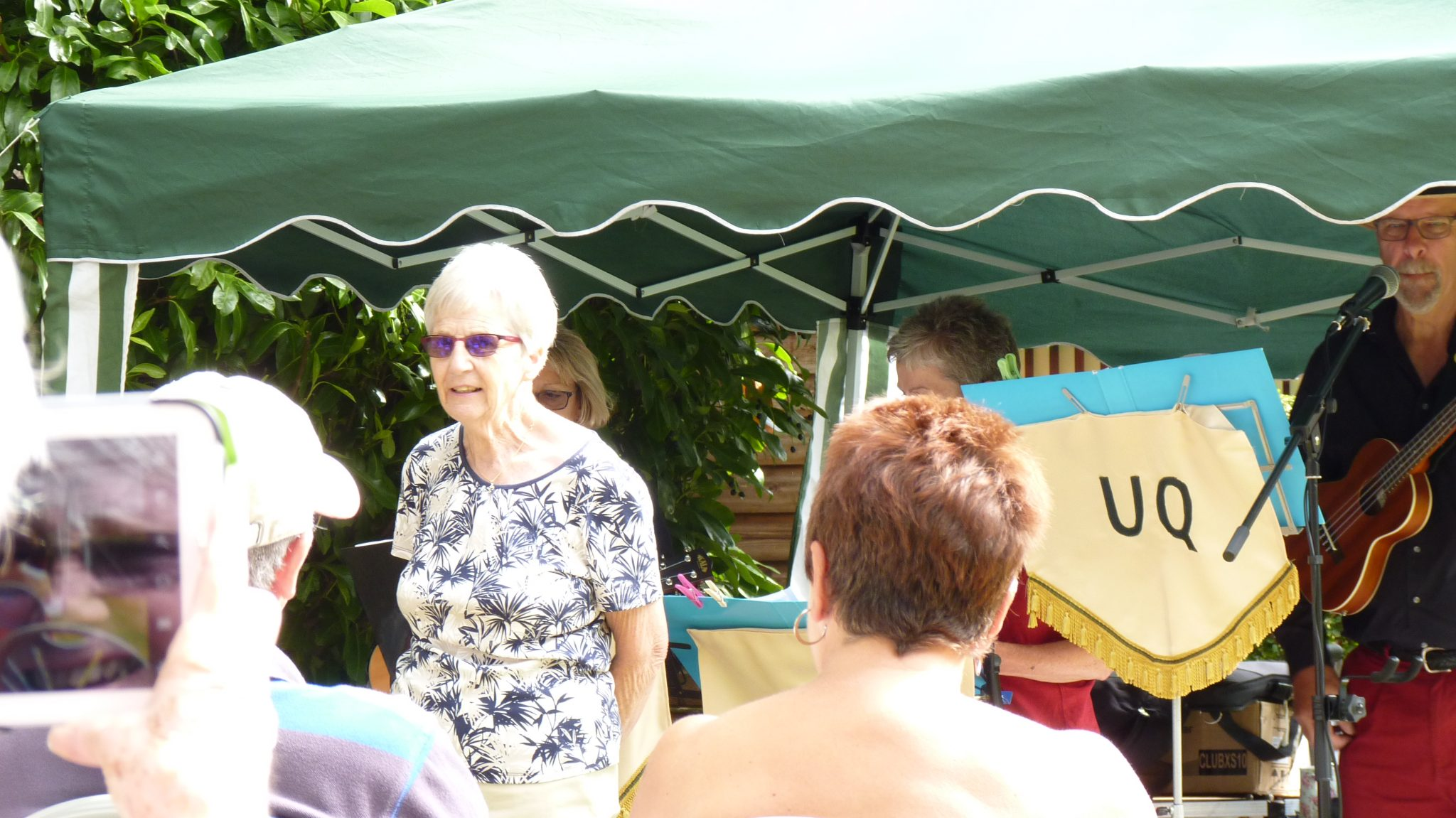 Our Chairman Gill Noble welcoming visitors to the garden and the free music event